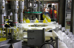 Bottling Liquid Detergent. Liquid detergent on automated production line. Machinery for bottling Stock Image