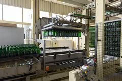 Bottling machine with many bottles Royalty Free Stock Photos