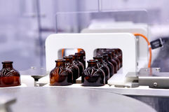 Bottling and packaging of sterile medical products.Machine after Stock Photos