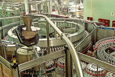 Bottling plant. Plant and Industrial machinery for bottling coca-cola soft drinks Stock Images