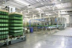 Bottling plant. Bottling line in a big industry Stock Images