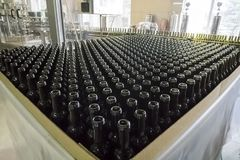 Bottling and sealing conveyor line at factory. Bottling and sealing conveyor line at winery factory royalty free stock images