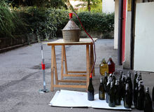 Bottling wine from the Carboy bottles Stock Photo
