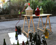 Bottling wine from the Carboy bottles Royalty Free Stock Photo