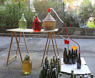Bottling wine from the Carboy bottles Royalty Free Stock Photos