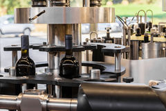 The bottling of wine. The bottling of a prized Italian wine industry Royalty Free Stock Image