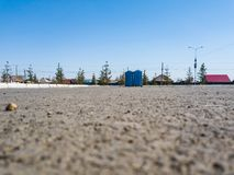Bottom of the asphalt on two blue dry closets in the park before the holiday for men and women without people under the blue clear. Sky on a sunny summer day in stock photography
