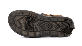 Bottom of a badly worn out sandal. On white Royalty Free Stock Photos