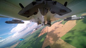 Bottom of the bomber`s fuselage SU-24 with armed bomb and two convoy fighters during russian air force readiness check stock video footage