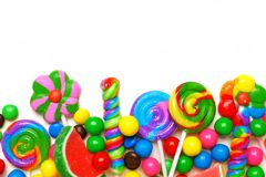 Bottom border of colorful candies over white. Bottom border of an assortment of colorful candies against a white background Stock Photos