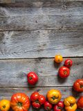 Bottom border of variety of organic earthy tomatoes, copy space. Bottom border of variety of many earthy tomatoes for organic mediterranean fruits, healthy royalty free stock images