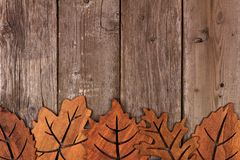 Bottom border of wooden autumn leaf decor Stock Image