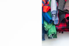 Bottom of boy jackets and winter clothes hanging in a real closet with lots of white space for copy, room for text royalty free stock images