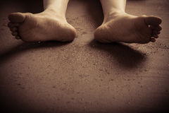 Bottom of dirty feet on ground Royalty Free Stock Images
