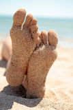Bottom of feet covered with sand Royalty Free Stock Photos