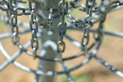 The bottom chains of a frisbee golf net. The bottom of a fribee golf net, or hole, just waiting to capture a disc or two thrown its way royalty free stock photography