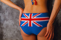 Bottom of girl in bikini. Flag of Great Britain Royalty Free Stock Photography