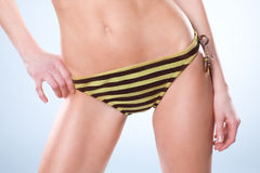 Bottom half of woman wearning a swimsuit Royalty Free Stock Photos