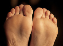 Bottom of her feet. Shallow depth-of-field image of the bottom of a females feet stock images
