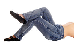 The bottom and legs of a lying woman. Royalty Free Stock Images