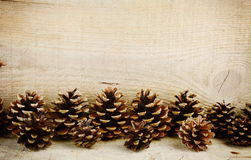Bottom line horizontal pine cones christmas on wooden Stock Photo