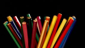 Bottom of lotsa different colour pencils on black stock footage