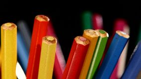 Bottom of lotsa different colour pencils on black stock video