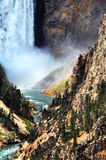 Bottom of Lower Falls. In Yellowstone National Park has thunderous spray and crashing water.  Yellowstone River curves and twists its way through the steep and Royalty Free Stock Photos