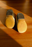 Bottom of old pair of child shoes Royalty Free Stock Photo