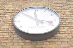 Bottom perspective of a large white clock Royalty Free Stock Photo