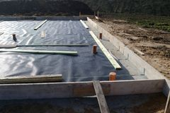 Bottom plate. Construction of a new house: floor plate with insulation Royalty Free Stock Image