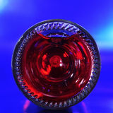 Bottom of a red sparkling wine bottle Royalty Free Stock Images