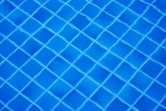 Bottom of swimming pool covered with tiles Stock Photos