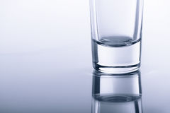 Bottom transparent glasses on the glass with reflection. Royalty Free Stock Photos