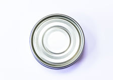 A bottom of tuna can on a white background. A silver circle made out of an image of a tuna can photographed from the bottom part over a white background Royalty Free Stock Photos