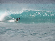 Bottom Turn. Surfer bottom turns to set up for the tube. Tropicana, Barbados stock images