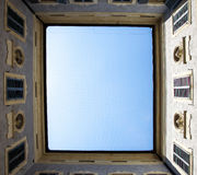 Bottom-up view from courtyard of historic building in Siena, Italy Royalty Free Stock Photography
