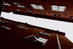 Geometric lines of facades and roofs of the old city houses stock photo