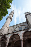 Bottom up view of mosque. Bottom to top view of a mosque with minaret Royalty Free Stock Photo