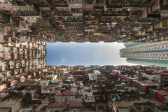 Bottom view against blue sky, Apartment crowded residence area. Hong Kong city Stock Photos