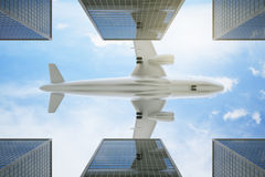 Bottom view of aiplane in bright sky. Bottom view of airplane flying above modern city in bright sky. Travel concept. 3D Rendering Royalty Free Stock Photos