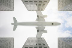 Bottom view of aiplane in dull sky. Bottom view of airplane flying above modern city in dull sky. Travel concept. 3D Rendering Stock Images