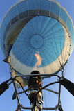 Bottom view in air-filled air  balloon and a gas burner with fir Stock Image