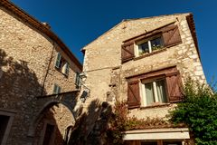 Bottom view of ancient stone buildings at old european town, Antibes, France stock photos