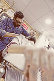 Bottom view of a barber shaving a beard Royalty Free Stock Photos
