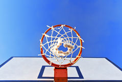 Bottom view of a basketball hoop in the street Stock Images