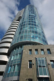 A bottom view of the beautiful multi-storey mirrored building of Royalty Free Stock Images