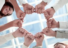 Bottom view. business team standing in a circle. The concept of victory stock image