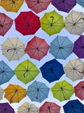 Bottom view of colored umbrellas in the blue sky royalty free stock photo