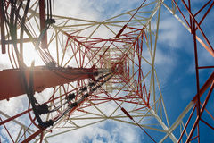 Bottom view of a communication tower. Bottom view of a communication tower with blue sky background Royalty Free Stock Photo